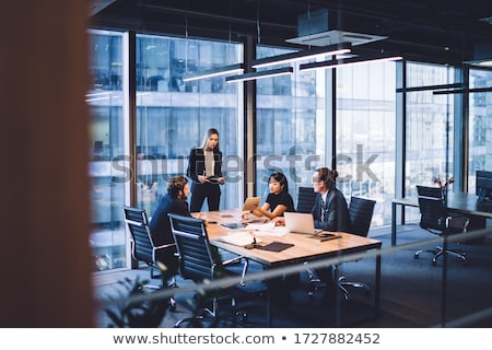 group of businesspeople discussing while working in office stock photo © andreypopov