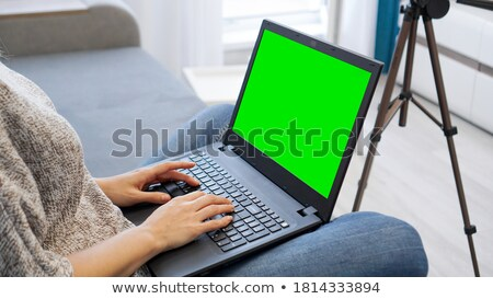 close up of a woman monitoring cameras live on digital tablet stock photo © andreypopov