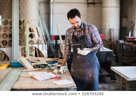 carpenters with tablet and blueprint at workshop stock photo © dolgachov