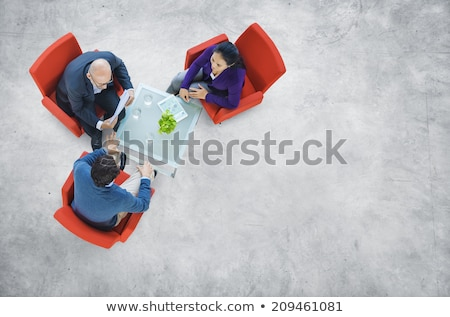 Business People Discussing Floor Plans Stock photo © pressmaster