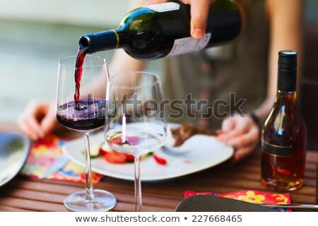 Delicious italian caprese salad and wine glass Stock photo © karandaev