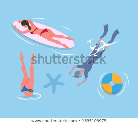 people diving legs up man in flippers and mask stock photo © robuart