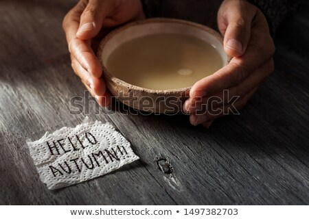 man with a bowl of soup and text hello autumn Stock photo © nito