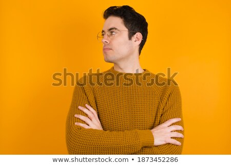Angry, disappointed and annoyed handsome young man, cross arms over chest displeased, looking from u Stock photo © benzoix