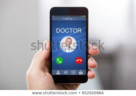 Médicos chamar homem olhando on-line Foto stock © AndreyPopov