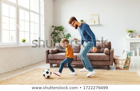 Mutlu baba küçük oğul oynama ev Stok fotoğraf © dolgachov