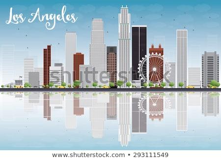 Los Angeles Skyline with Grey Buildings and Blue Sky. Stock photo © ShustrikS