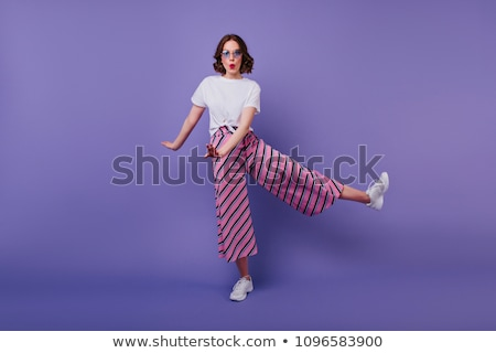 Full length portrait of a beautiful young short haired woman Stock photo © deandrobot