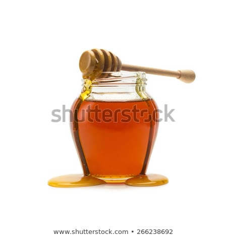 Honey pitcher and wooden drizzler Stock photo © broker