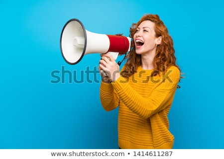 Ginger haired girl speaking into megaphone Stock photo © photography33