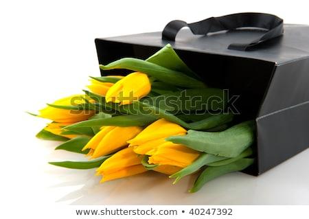 Yellow tulips in black paper bag Stock photo © ivonnewierink