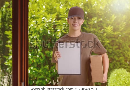 Female courier with parcels and a clipboard Stock photo © photography33