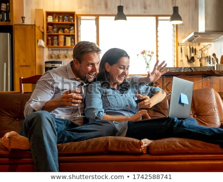 Stock photo: Young couple at ease together at home