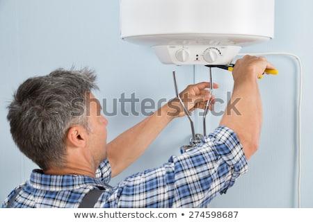 electrical and plumbing installation in kitchen work stock photo © lunamarina