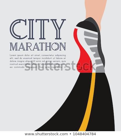 Yalıtılmış kadın maraton koşucu aşağı Stok fotoğraf © stockyimages