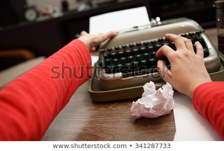 woman writing and crumbling papers Stock photo © photography33