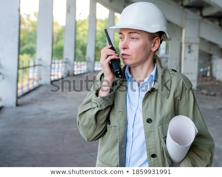 young female worker holding talkie-walkie and plan Stock photo © photography33