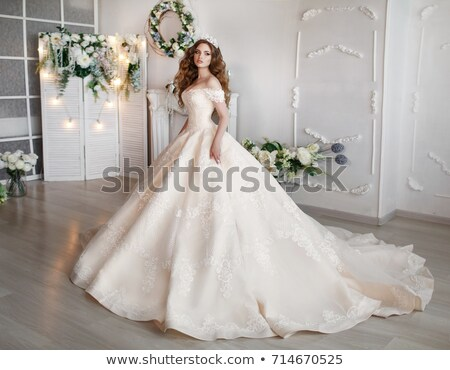 Fashion model lovely female in bridal dress posing in studio stock photo © gromovataya