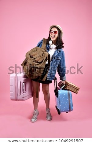 Woman carrying suitcase Stock photo © photography33
