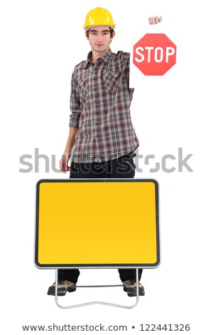 young bricklayer holding stop sign stock photo © photography33
