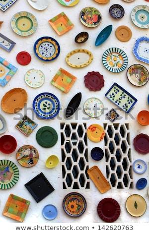 Stock photo: Artisan's wall of handpainted plates