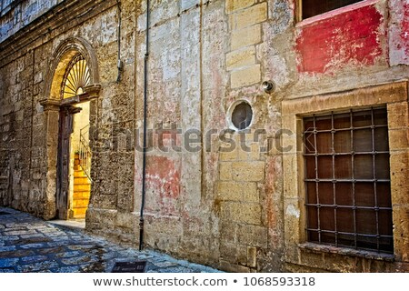 Cobbled street and red brick wall in italian town. Stock photo © rglinsky77
