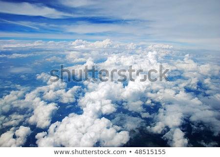 Widok z lotu ptaka spokojny ziemi pokryty chmury drzewo Zdjęcia stock © rufous