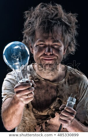 Electrocuted man holding a light bulb Stock photo © photography33