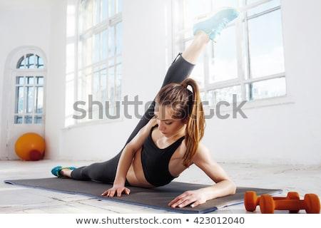 genç · kadın · egzersiz · yoga · mat · yandan · görünüş · mutlu - stok fotoğraf © hasloo