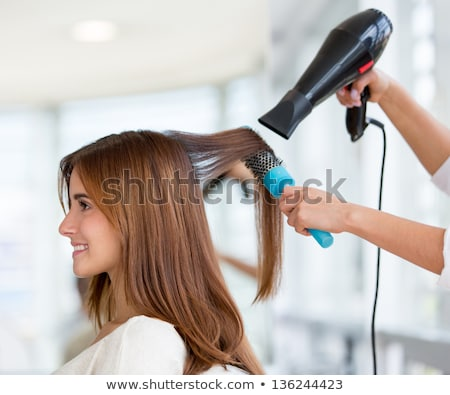 happy girl blow drying her hair stock photo © candyboxphoto