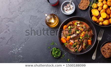 Meat in sauce with vegetables Stock photo © yelenayemchuk