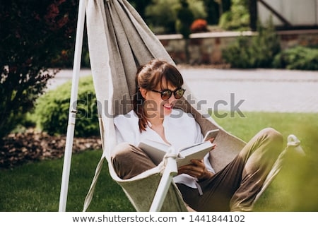 Woman lieing in a chair Stock photo © gemenacom