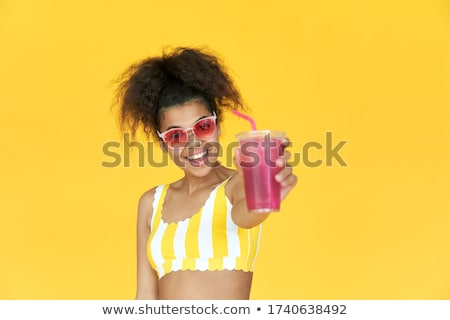 Stock photo: Laughing woman enjoying a tropical cocktail