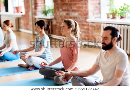 Man meditates in the Lotus position. Stock photo © jossdiim