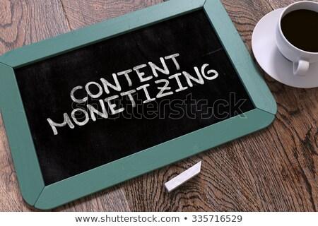 Content Monetizing Handwritten by White Chalk on a Blackboard. Stock photo © tashatuvango