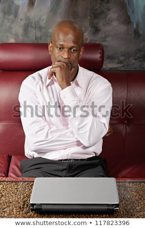 Middle Aged Man in African Shirt Looking Sideways Stock photo © ozgur