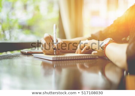 Woman writing recipient address on mailing envelope Stock photo © stevanovicigor