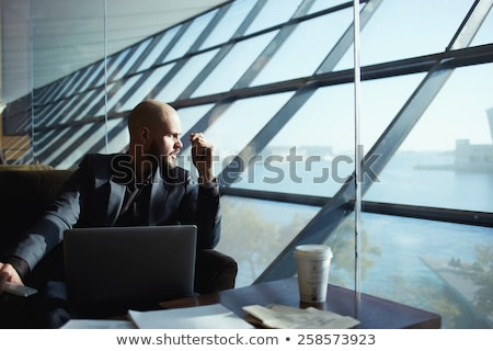 Stock photo:  pensive young business man looking to side