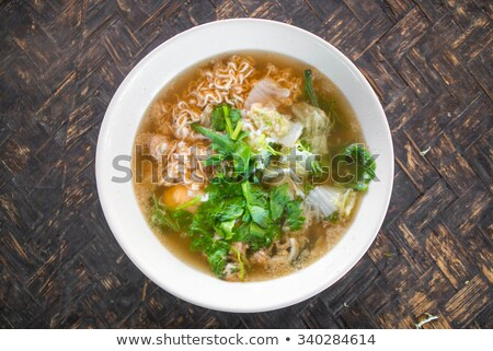 top down view of pasta and spoon in bowl stock photo © ozgur