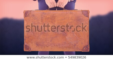 Composite image of mid section of man holding briefcase Stock photo © wavebreak_media