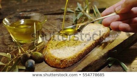 Extra szűz olívaolaj kenyér klasszikus üveg Stock fotó © marimorena