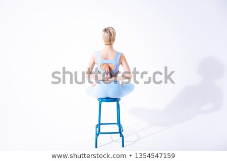 beautiful young blonde haired woman with a sports figure in denim shorts and a black bra standing s stock photo © traza