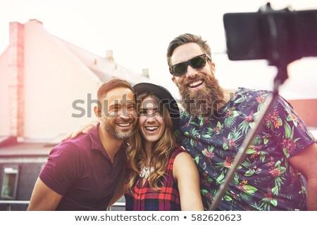 Three vivacious smiling women taking a selfie Stock photo © dash