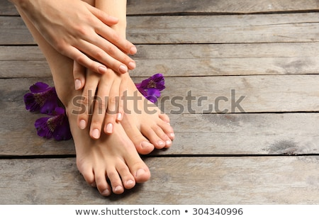 Female feet and hands on wooden floor Stock photo © Nobilior