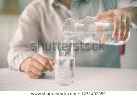 Young man with glass of water Stock photo © Elnur