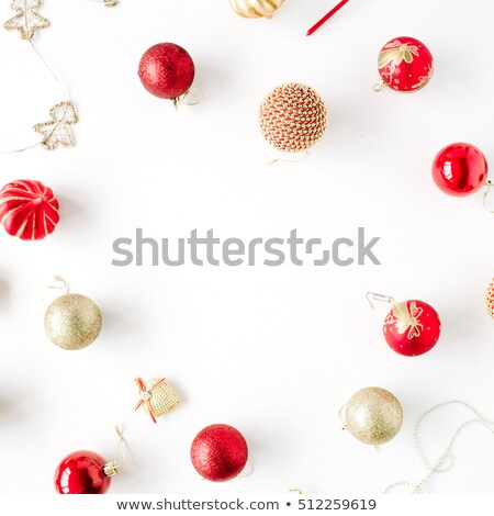 red background made with golden christmas balls decoration Stock photo © SArts