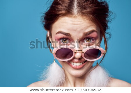 Surprised woman with red lips looking at her glasses Stock photo © julenochek