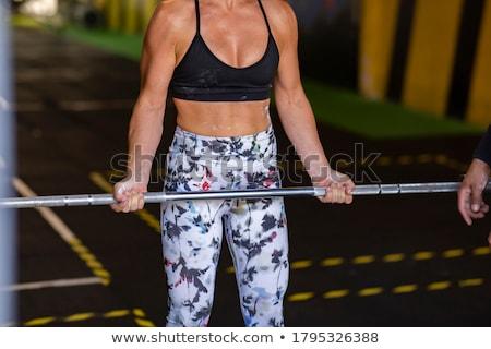 beautiful anonymous woman doing biceps exercises stock photo © julenochek