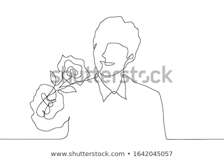 Man giving flowers to the viewer Stock photo © IS2