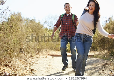 man & woman carrying rucksack Stock photo © IS2